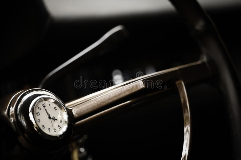 Vintage steering wheel with clock royalty free stock photography