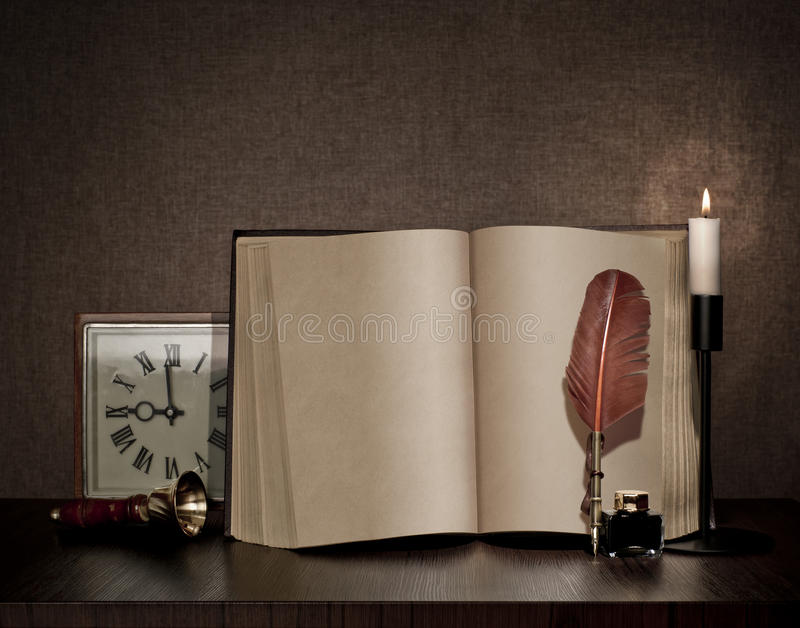 Vintage book, pen, watch and candle royalty free stock image