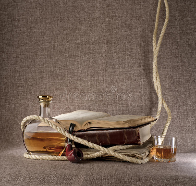Vintage books, whiskey and tobacco pipe stock photo