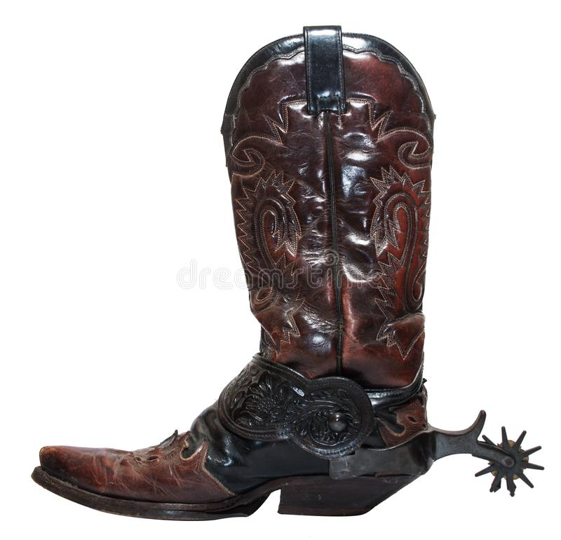 Vintage stivali da cowboy con sporgenze isolate su fondo bianco fotografie stock