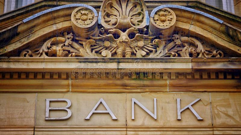 Vintage Bank Sign in Stone royalty free stock images