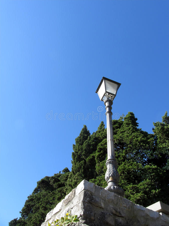 Vintage street lamp against blue sky stock photography