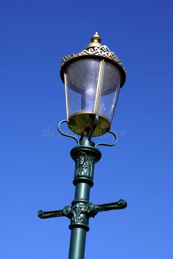 Vintage street lamp post in London, England. Outdoor street decoration of vintage Victorian electric street lamp in London, England royalty free stock photo