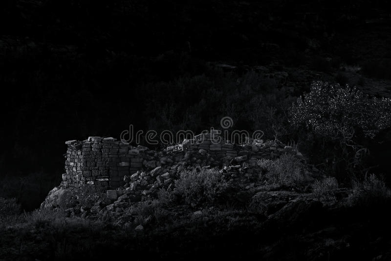 Vintage Style B&W Moonlit Ancestral Puebloan Anasazi Tower. Dramatic B&W photo of a fallen Anasazi tower in the moonlight stock images
