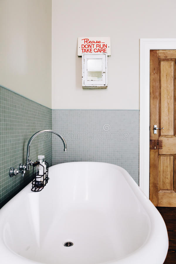 Vintage style bathroom with quirky retro safety sign royalty free stock image