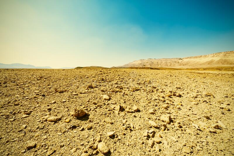 Vintage Style Desert. Breathtaking landscape of the rock formations in the Israel desert. Dusty mountains interrupted by wadis  and deep craters. Vintage Style royalty free stock image