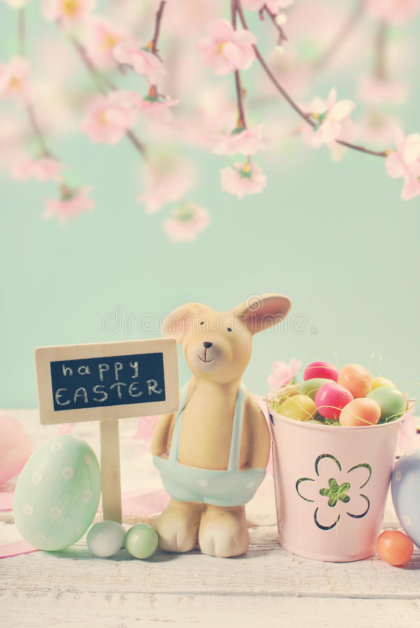 Vintage style easter card with clay rabbit and decorations on m royalty free stock photos