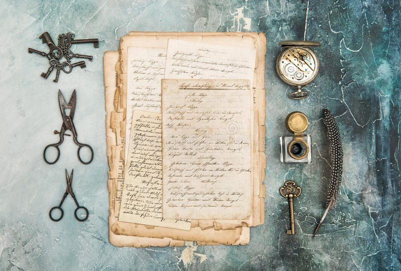Vintage style flat lay used paper sheet antique objects. Vintage style flat lay with used paper sheet and antique objects on concrete stone background stock photos