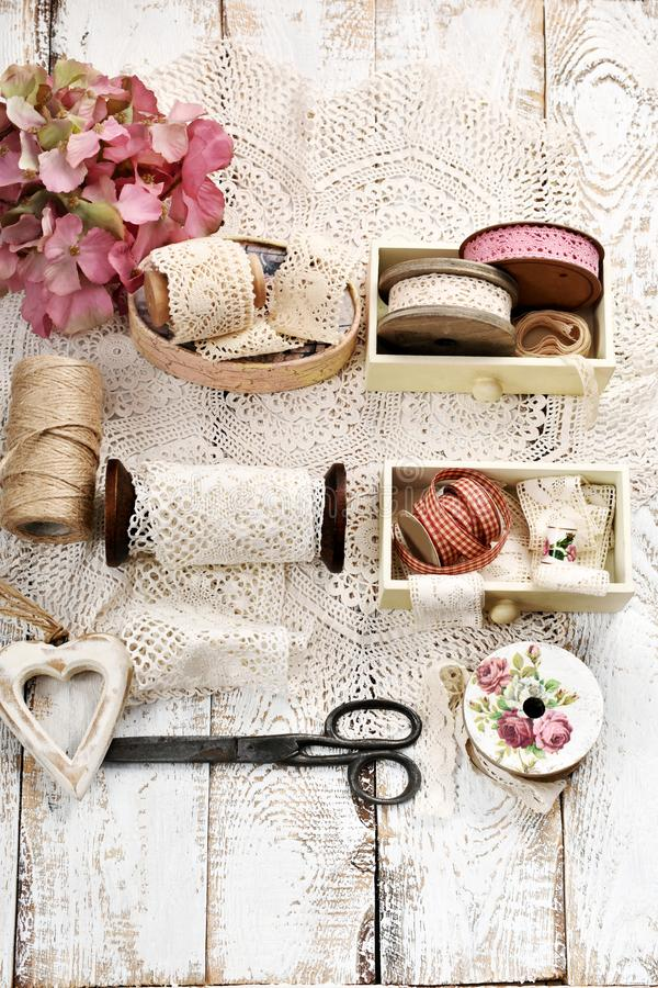 vintage style flatlay photo with lace trim spools and accessories royalty free stock image