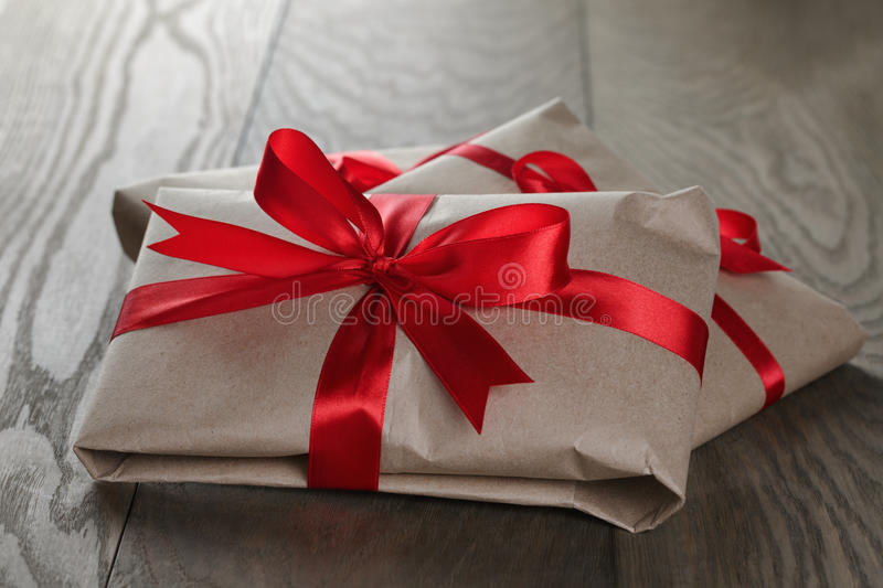 Vintage style gifts tied with ribbon and bow. On old oak table stock images