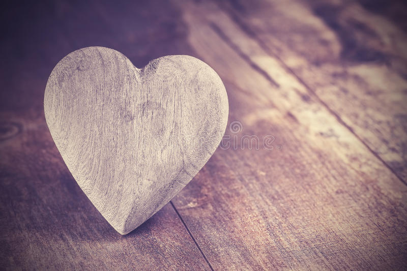 Vintage style heart on rustic wooden background, copy space stock images