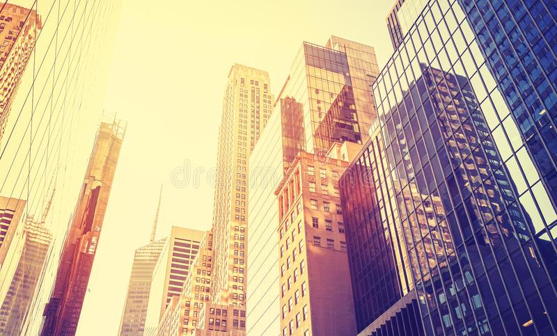 Vintage style Manhattan skyscrapers at sunset. stock photography