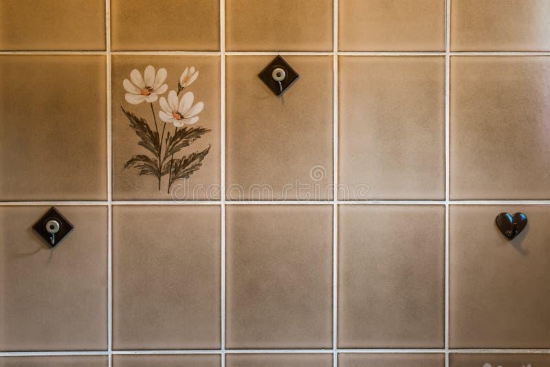 Vintage style, old retro towel hanger hooks on retro bathroom tiling, home interior background. A vintage style, old retro towel hanger hooks on retro bathroom royalty free stock photos