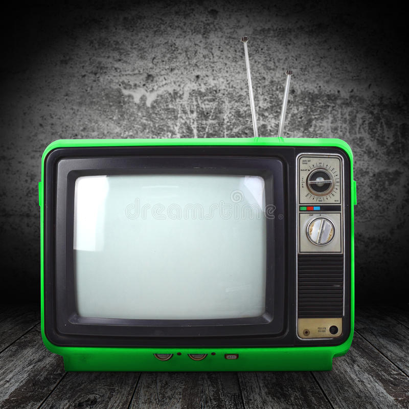 Vintage style old television. Isolated on grunge background royalty free stock photos