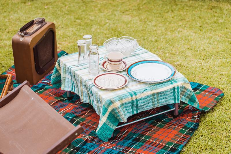 Vintage style picnic setup on grass royalty free stock images
