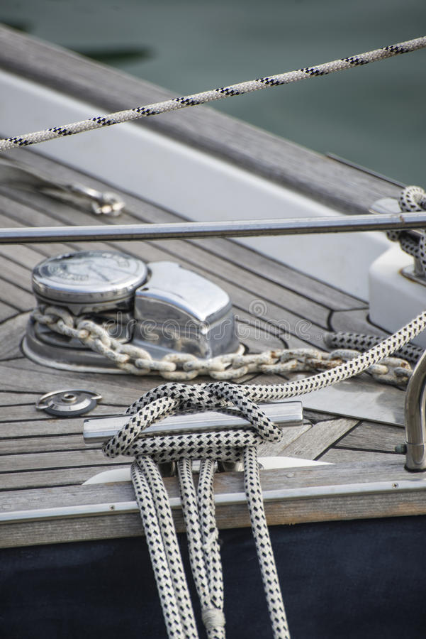 Vintage style picture of beautiful sail boat details. Rope, hull. Vintage picture of beautiful sail boat details. Rope, hull, rigging sailing yacht background stock photo