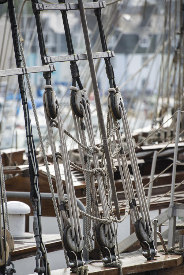 Vintage style picture of beautiful sail boat details. Rope, hull. Vintage picture of beautiful sail boat details. Rope, hull, rigging sailing yacht background royalty free stock image