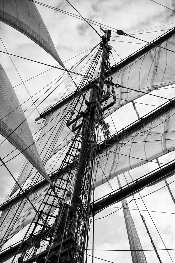 Vintage style picture of beautiful sail boat details. Rope, hull. Vintage picture of beautiful sail boat details. Rope, hull, rigging sailing yacht background royalty free stock images