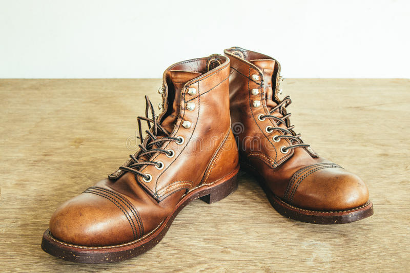 Vintage style picture with safety boots and Industrial boots stock photo