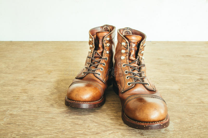Vintage style picture with safety boots and Industrial boots stock photography