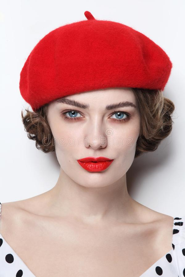 Vintage style portrait of beautiful woman with red lips stock photography