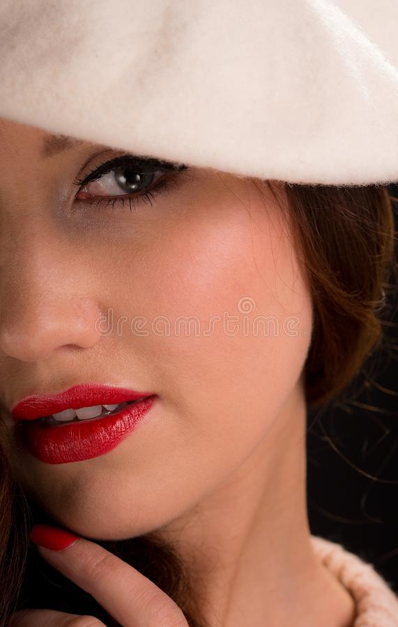 Vintage style portrait of beautiful young woman wearing a beret hat. royalty free stock photography