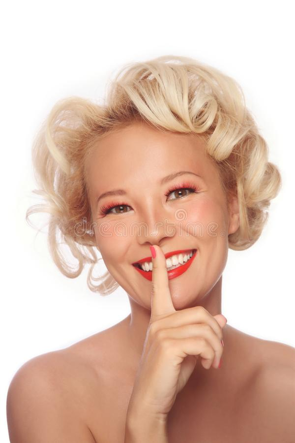 Vintage style portrait of blonde asian woman with fancy prom hairdo stock photography