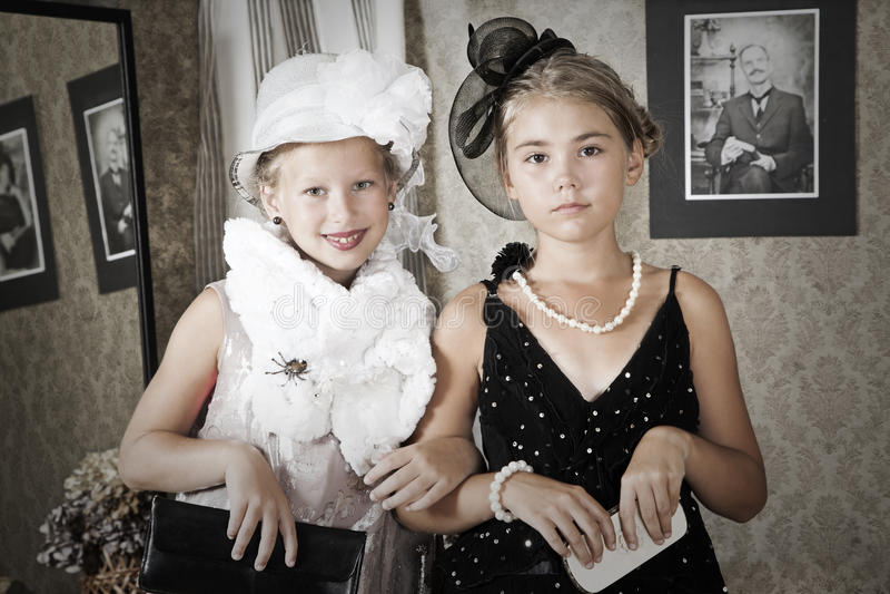 Vintage style portrait of children stock photo