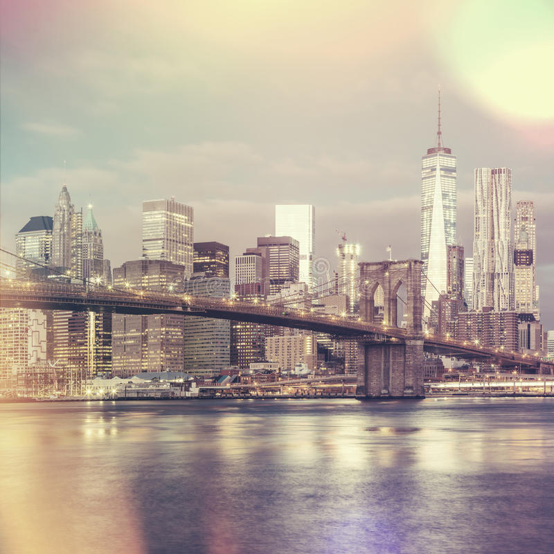 Vintage style view of Brooklyn Bridge and Manhattan skyline, Ne. Vintage style view of Brooklyn Bridge and Lower Manhattan skyline in New York City with city stock photos