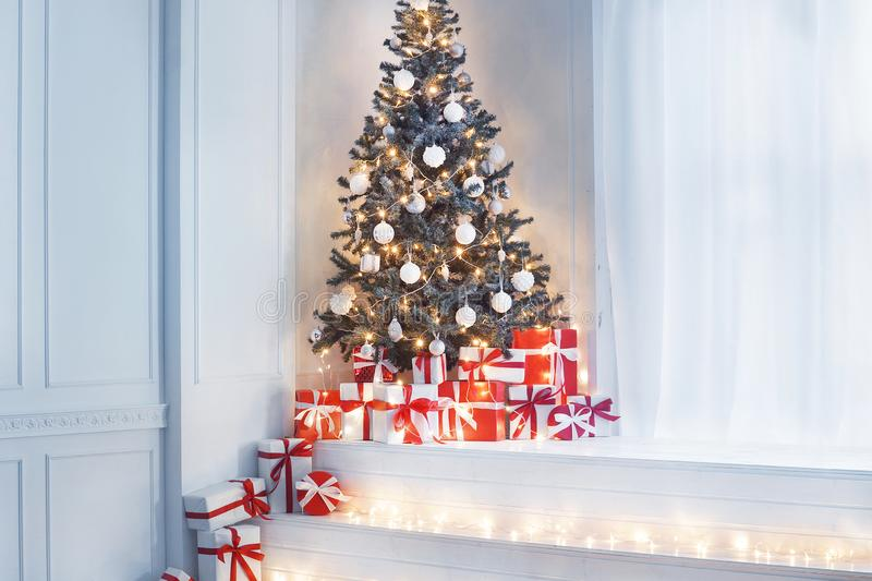 Vintage styled interior with a Christmas tree. Winter holidays concept. Vintage styled interior with a Christmas tree and gift boxes. Winter holidays concept royalty free stock photo
