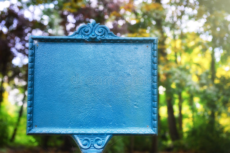 Vintage styled sign board in autumn park stock photos