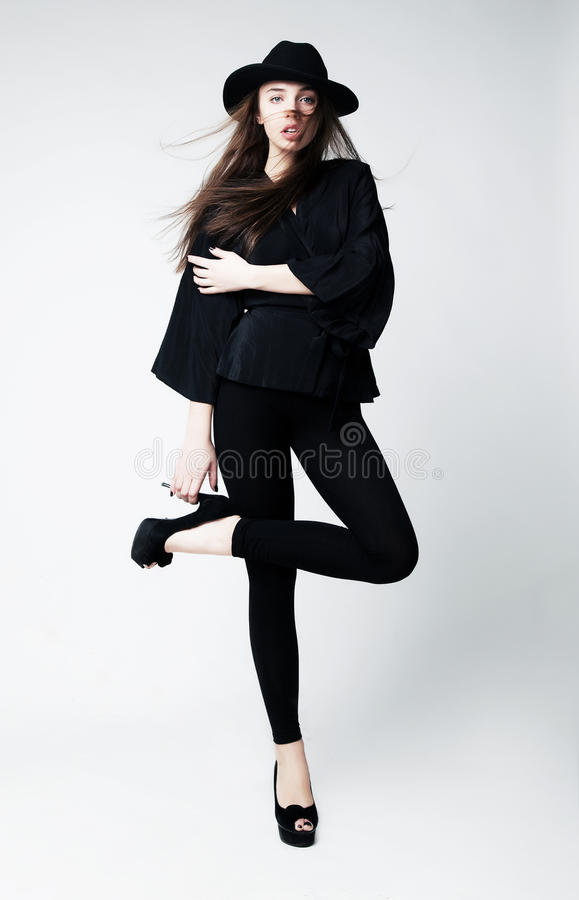 Vintage - stylish caucasian girl in black clothes stock photography