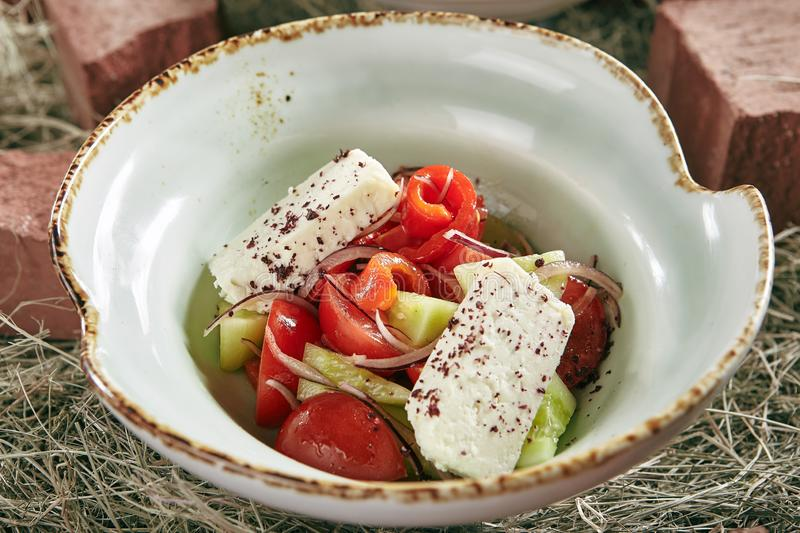 Vintage Stylized Fresh Vegetable Salad with Fragrant Herb Cheese royalty free stock images