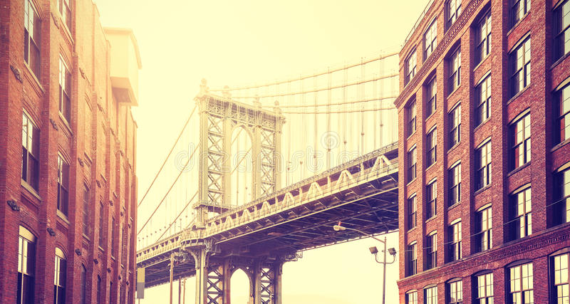 Vintage stylized Manhattan Bridge seen from Dumbo, New York. Vintage stylized Manhattan Bridge seen from Dumbo at sunset, New York royalty free stock photos