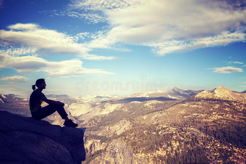 Vintage stylized silhouette of a woman watching mountain view. royalty free stock photos