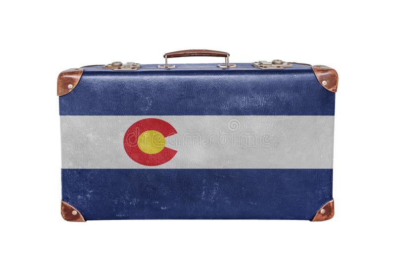 Vintage suitcase with Colorado flag. Isolated on white background close stock images