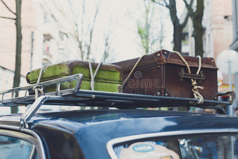 Vintage suitcase on an old car roof rack. stock photo