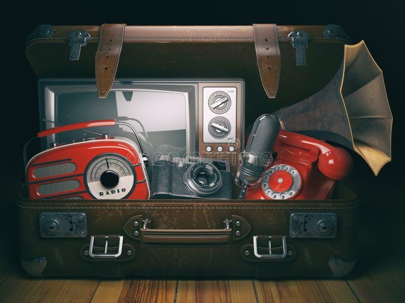 Vintage suitcase with old obsolete electronic equipment set. Retro technology concept background. Radio, tv set, telephone camera royalty free illustration