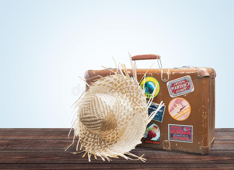 Vintage Suitcase with Straw Hat on wooden floor royalty free stock photos