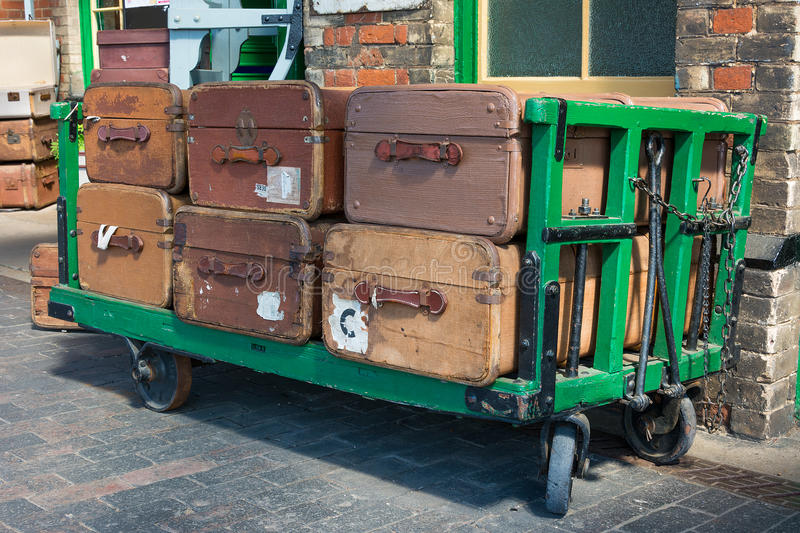 Vintage suitcases and trolley