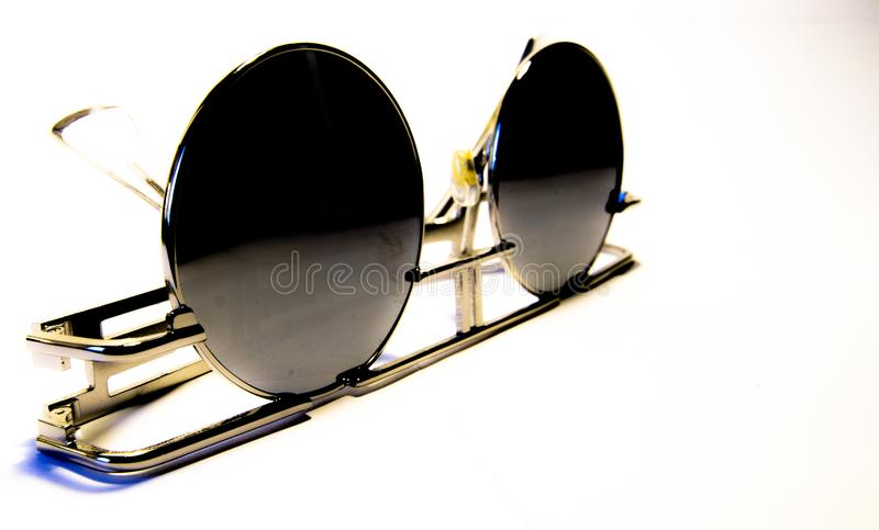 Vintage sun glasses, contrasted on the white background. Vintage sun glasses, made from metal, contrasted on the white background, fashion. Round glasses, metal royalty free stock images