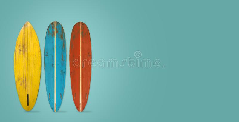 Vintage surfboard on color background. Flat lay, top view hero header. vintage color styles royalty free stock photo