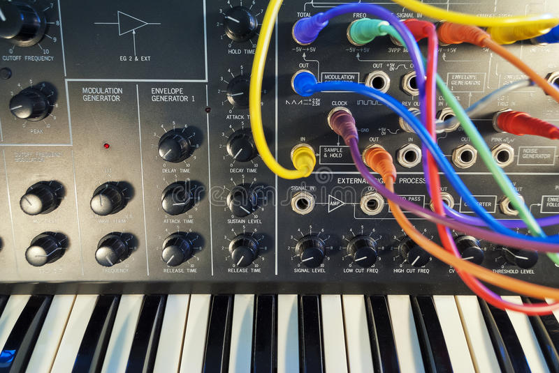 Vintage synthesizer with colorful path cables stock photography