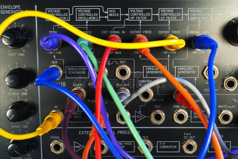 Vintage synthesizer with colorful patch cables stock photography