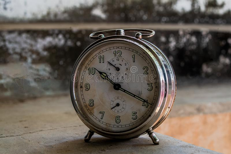 Vintage Table Clock Kukadiya Idar district Sabarkantha Gujarat INDIA. 25 Feb 2017 Vintage Table Clock Kukadiya Idar district Sabarkantha Gujarat INDIA stock photos