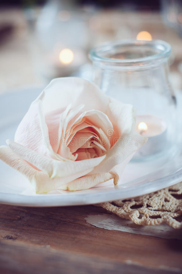 Vintage table setting with beige rose
