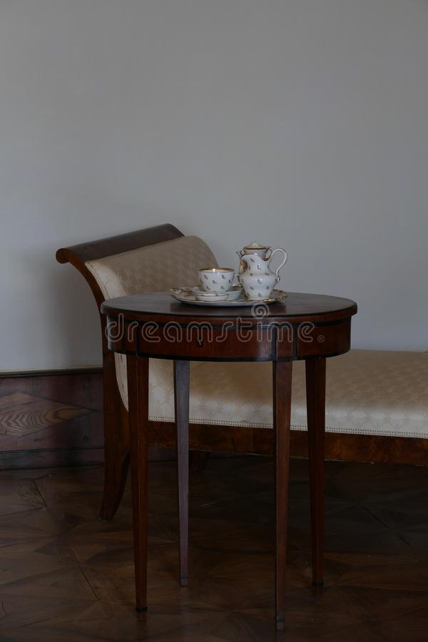 Vintage table and sofa. Interior royalty free stock images