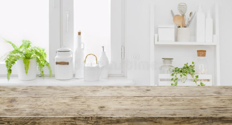 Vintage tabletop for product display with defocused modern kitchen background stock images