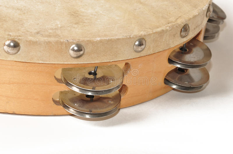 Vintage Tambourine. Old tambourine with an skin head and old patina stock photos