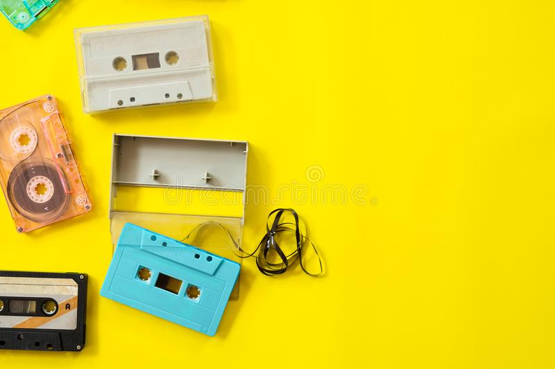 Vintage tape cassette recorder on yellow background stock photos
